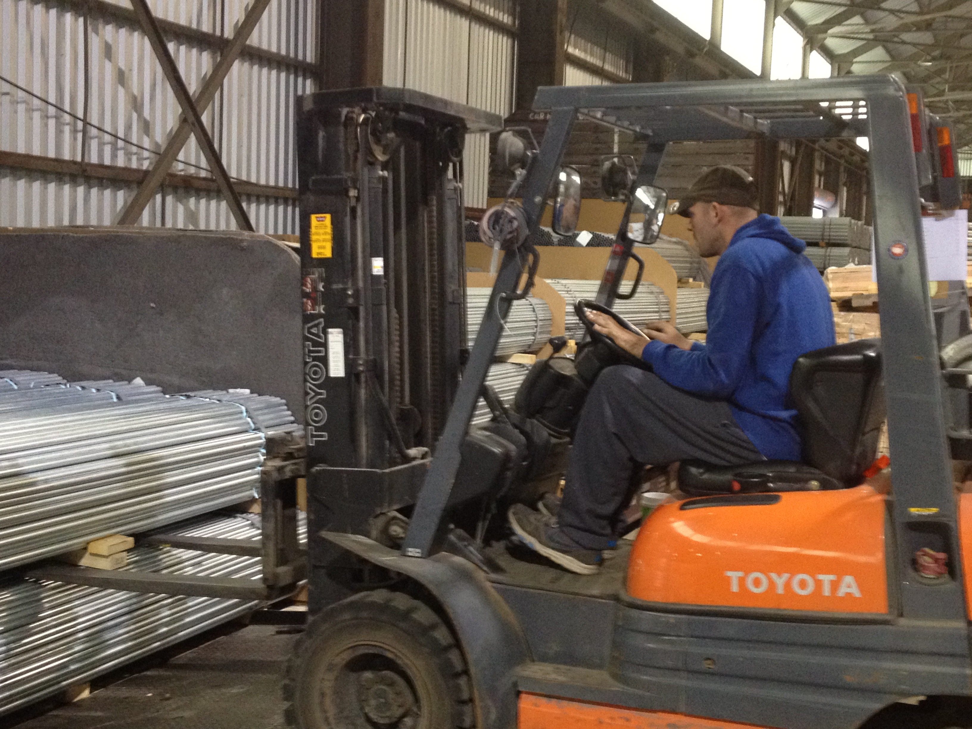 A person using a forklift